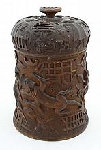 An unusual 119thC Burmese carved wooden tobacco pot decorat