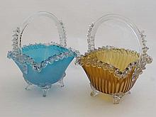 Webb : A pair of Victorian glass baskets with blue and ambe