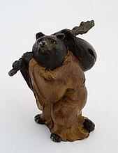 A cold painted bronze of a bear with staff and travel bag a