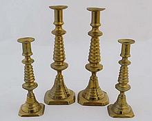 Four (2+2) c.1895 brass candlesticks with unusual skep like
