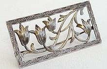 A Continental 900 silver brooch of rectangular form with fl