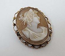 A cameo brooch depicting a classical figure within a a 9ct