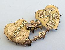 A 9ct gold Mizpah brooch with heart bow and foliate decorat