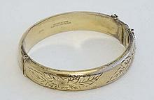 A silver gilt bangle bracelet with engraved floral decorati