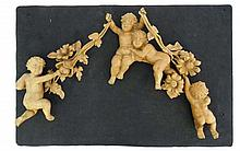 Four 19thC limewood carved putti connected by similarly car