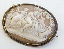 A cameo brooch depicting a Bacchanalian scene within a gilt
