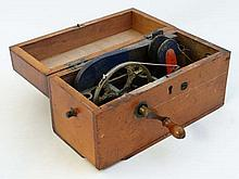 An early 20thC wooden cased electric shock machine with cra