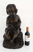 A large Victorian style wooden carving depicting a seated c