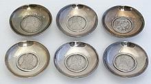 Coins: A set of 6 bon bon dishes set with Austrian 1780 sil
