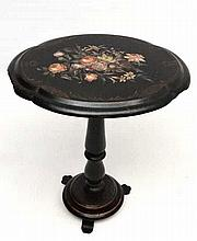 A Victorian papier-mache tilt top tripod table with hand painted gilt and f