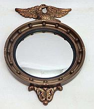 Atsonea; A mid 20thC gilt circular convex mirror with gilt gunshot frame su