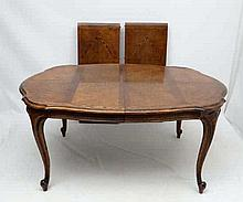 A 20thC Italian extending walnut dining table together with 6 matching cane