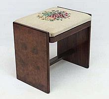 An Art Deco burr walnut dressing table stool with woolwork upholstered seat