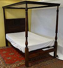 An 18thC and later oak and beech four poster 4ft bed with panelled headboar