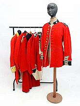 A collection of six 20thC British military Scarlet Jackets, comprising two