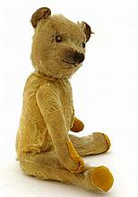 A mid 20thC articulated limb teddy bear with original squeaker to chest, go