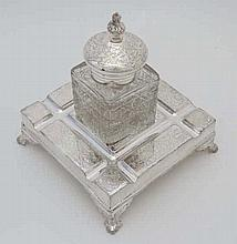 A 20thC silver plate inkwell / Standish with central cut glass bottle. The