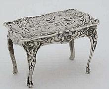 A.925 silver miniature dolls house table C-scroll and cherub decoration. Ma