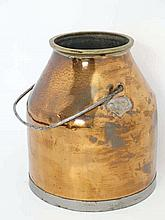 A 19thC copper milking churn with brass rim and steel metal swing handle 14