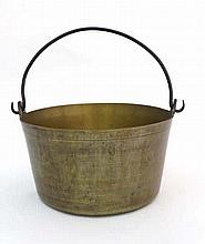 A 19thC brass jam pan with wrought iron swing over handle. 13 1/8