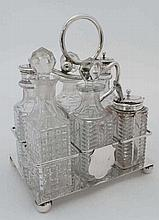 An early 20thC silver plate cruet stand with four squat bun feet and loop h