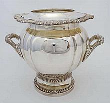 A late 20thC silver plate wine cooler / champagne bucket with twin handles
