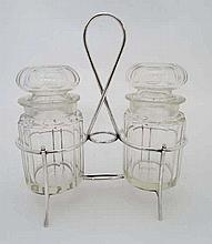 An early 20thC silver plate pickle cruet, the silver plate stand with loop