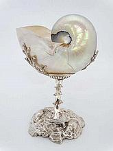An early 20thC nautilus shell on stand, the silver plate pedestal stand wit