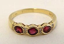 A 585 (14ct) gold ring set with rubies and diamonds.  Please Note - we