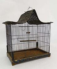 An early 20thC bird cage with rattan top and with pair of pendant perches.