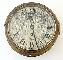 Ship's Clock  : a brass cased timepiece  marked Smith Empire with 5 3/4'' d
