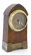 Arts and Crafts : a crossed arrows (HAC ) brass and oak alarm clock strikin