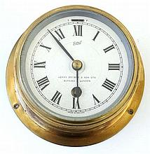 Ship's Clock : an brass cased 30 hr Timepiece , marked ' Sestrel ' with sil