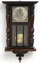 Clock : an early 20 thC Walnut cased 8 day Wall clock with sprung movement