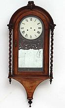 Clock : a 19 thC Rosewood cased arch topped wall clock, striking on a gong,