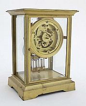 French Gilded Four- Glass Clock : a mantel clock with sprung powered escape
