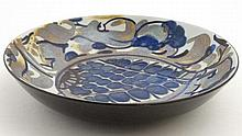 A Royal Copenhagen Faience dish of circular form decorated in shades of blu