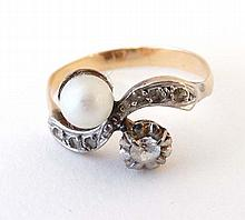 A yellow metal ring set with pearl and white stones