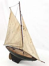 An early 20thC wooden gaff rigged sloop Pond Yacht having brown painted woo