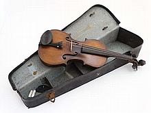 Musical Instruments : A cased 19thC Italian Violin , the body of maple with