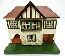 A Triang wooden 1950s Stockbroker dolls house, number 61 , having remains o