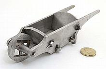 An aluminum model of a garden wheelbarrow with peg joints. 7 1/4'' long