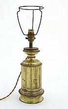 Light : An early 20thC gilt brass table lamp in the form of a lower part of