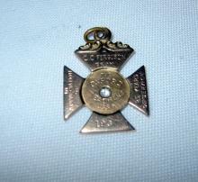 10k Gold Cross/Medal with Diamond