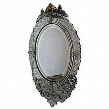 Venetian Style Mirror Framed Mirror   With an oval mirror plate and mirrored border. Height 59 inches, width 34 inches.