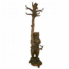 Black Forest Carved Walnut Hall Tree   Late 19th century Depicting a standing bear beside a tree, a cub in the branches. ...