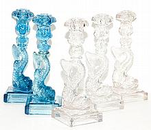 Group of Five Pressed Glass Figural Candlesticks