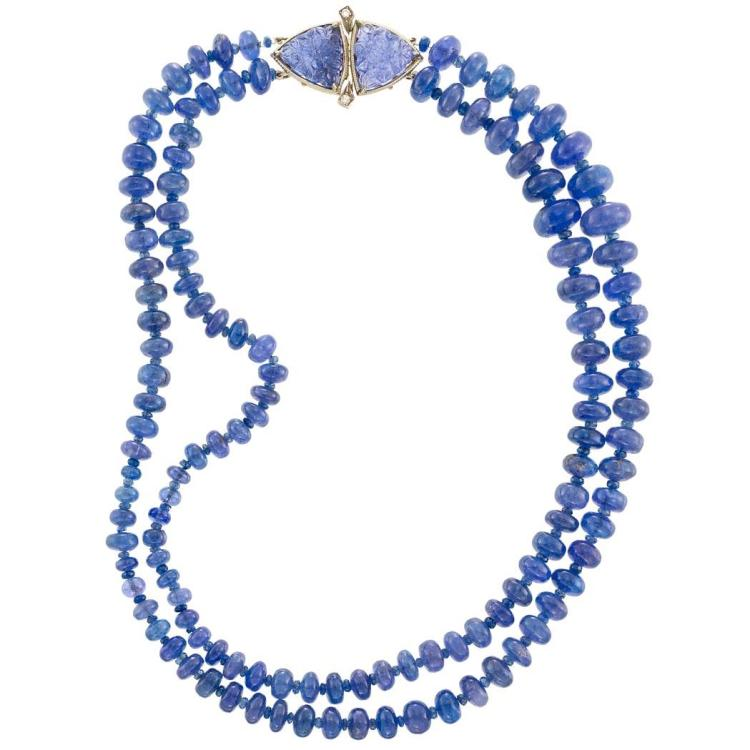 strand tanzanite bead necklace with white gold carve