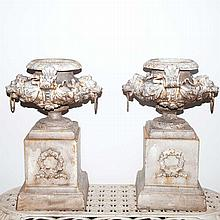 Pair of White Painted Cast Iron Urns on Pedestals