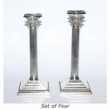 Set of Four Silver Plated Columnar Candlesticks